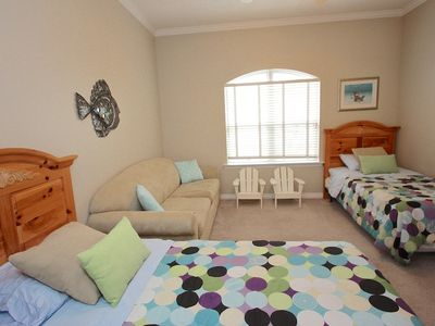2nd floor bedroom has two twin beds, queen sofa bed, tv, hosts four guests