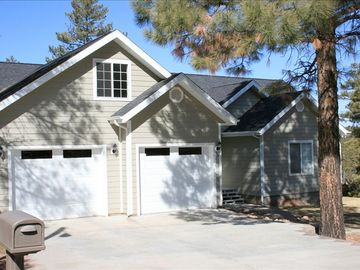 Show Low house rental - The front view of the house shows the tall pines that surround the house.