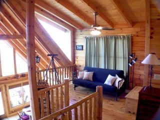 Golden Valley cabin photo - Loft area with with chess board and telescope