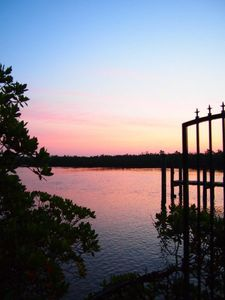 Keewaydin Island house rental - Sunrise from our dock, overlooking the channel.