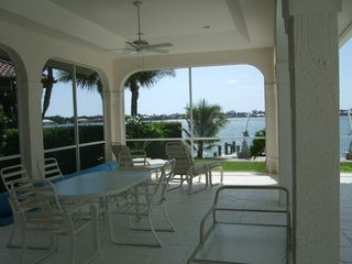 Vacation Homes in Marco Island house photo - Covered lainai Endless views, Dolphin & Manatee frolick - Marco Skyline back