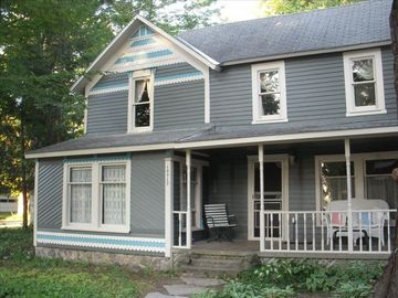 "Alden house rental - Enjoy the front porch and its settee or swing: picture ""a glass of wine & th"