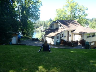 Large back yard (1 acre property). Cottage on left just steps from main house.