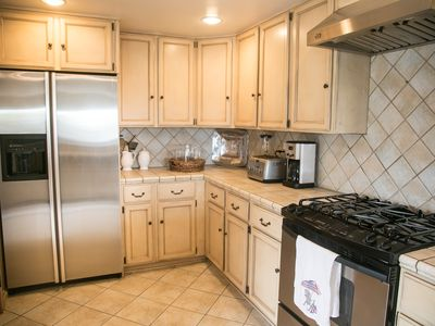 Large fully stocked kitchen with high end appliances