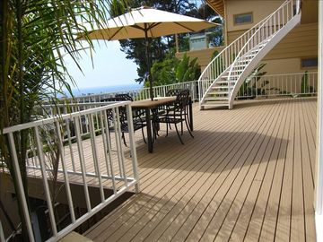 LARGE DECK WITH VIEW OUTSIDE THE DOWNSTAIRS BEDROOMS