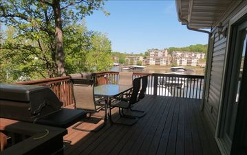 Large deck 13' x 22' overlooking cove with new grill and seating for 10 or more.