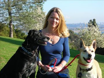 Liz Oshant, the Owner with her pups, Vega, and Dinga