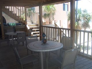Another angle of the covered deck. Furniture subject to change. - Fort Myers Beach house vacation rental photo