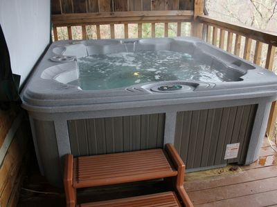 enjoy the privacy of the hot tub and the twinkling lights downtown at night