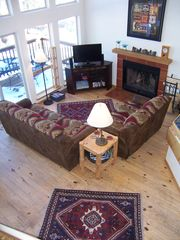 Angel Fire house photo - Family room with couch, loveseat, flat screen TV, and fireplace.