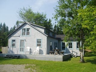 Baddeck house photo - Side View of Boat Cottage with Tabled Porch Dining Area