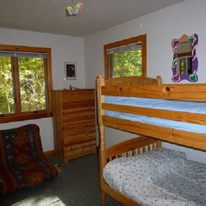 upstairs bedroom with bunk bed and futon