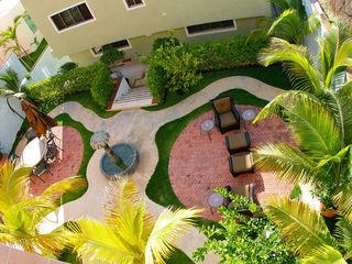 Playacar house photo - Private courtyard with fountain, gas BBQ and seating area