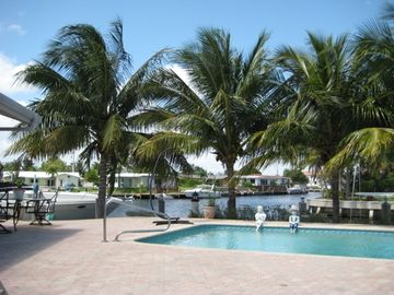 Pompano Beach house rental - View from the kitchen, canal, pool and the hot tub would be to the left