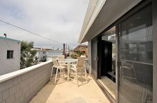 Mission Beach house photo - Private Penthouse balcony with grill bistro with umbrella and lounge.