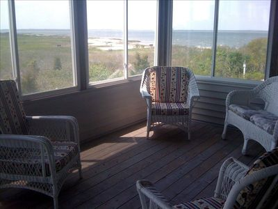 Sunroom with bay view
