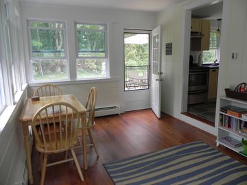 Sunroom with door to back deck