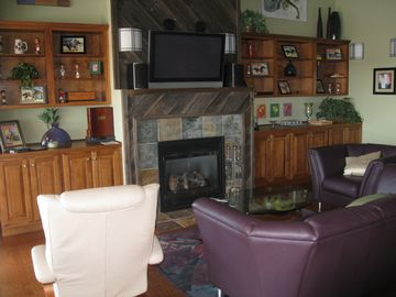 living area, fireplace and flat screen TV