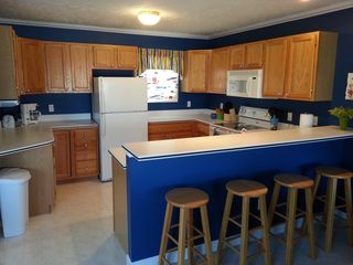 Manistee condo photo - Fully equipped kitchen, breakfast bar with stools