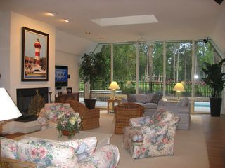 Sea Pines house photo - Living room overlooks pool and golf course