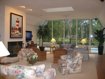 Living room overlooks pool and golf course