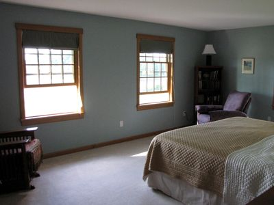 King-sized bed in the master suite, more water views!.
