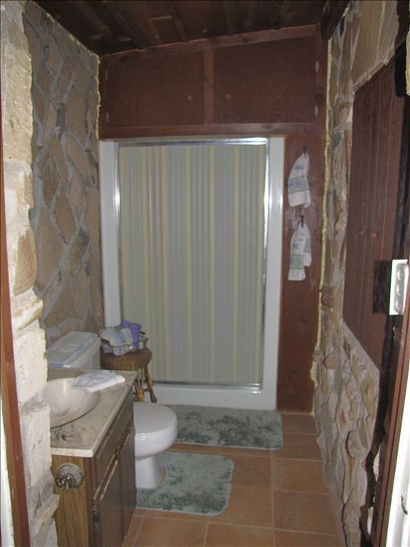 Master bath features native rock walls