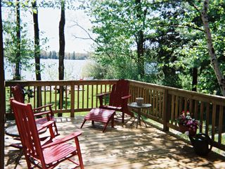 Relaxing Deck Overlooking Patio, Beach, Lake - Interlochen house vacation rental photo