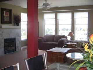 Fireplace in family room which overlooks marina