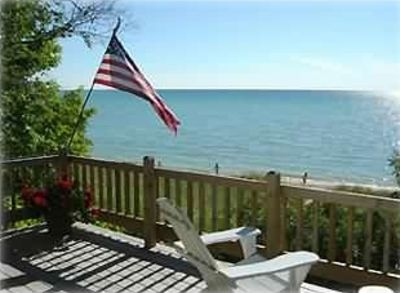 Good Hart cabin rental - Large deck overlooking beach and lake