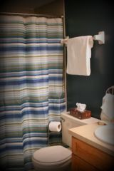 Indian Shores condo photo - The Main Bathroom features a Walk-In Shower.