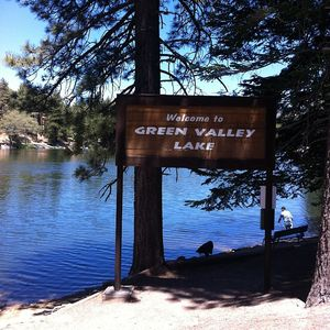 The rustic sign in front of Green Valley Lake right before entering town.