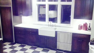 Updated gourmet kitchen with marble countertops