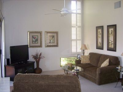 Living room - light, airy, high ceilings, couch and chair open to beds!