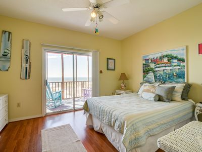 second bedroom with view of beach via the enclosed porch