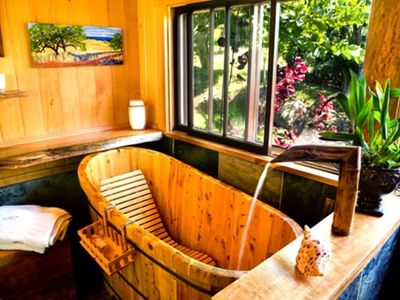 Hand crafted tub with bamboo filler.  Views to the garden while you soak!