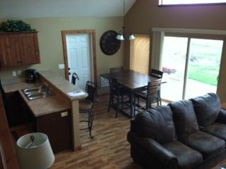 Okoboji cabin rental - View into living room from stair to loft