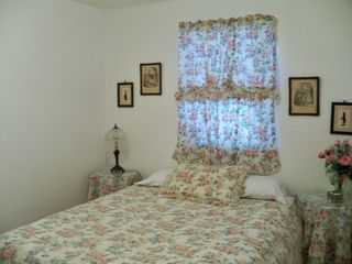 St. Augustine cottage photo - Rose Cottage Bedroom with queen bed, dresser, mirror, TV and large closet