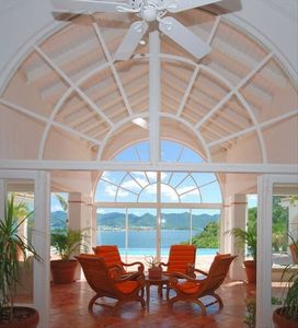 Enter this West Indian style villa to breathtaking water and mountain views!