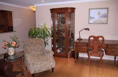 Comfortable desk, extendable arm-chair and display curio with glass shelves.