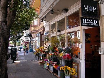 Flowers shops, post office, bakery, coffee shops, clothing shops all on 24th St.