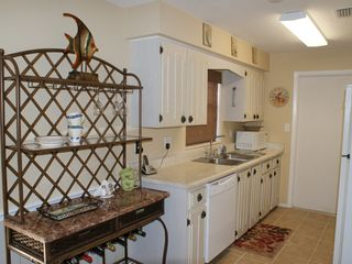 Indialantic house photo - Fully stocked Galley kitchen with a mural over the stove-beautiful!