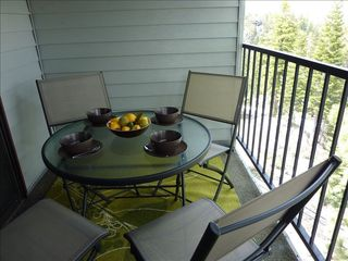 Stateline condo photo - Back Balcony - table & chairs, BBQ, & amazing views of Carson Valley & Mountains