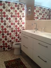 St Pete Beach house photo - Bathroom with double vanity sinks and roomy tub with extended shower area.