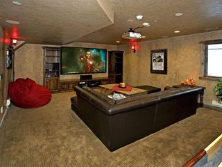 Sundance cabin photo - Game/entertainment room with HD projector and large seating area.