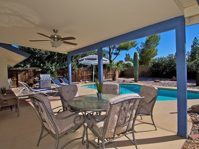Enjoy meals outside under the large covered patio complete w/ ceiling fan.