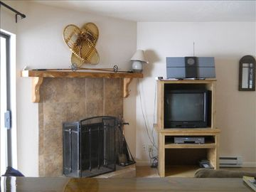Woodburning Fireplace, old snow shoes, and wooden ski poles add to the decor.