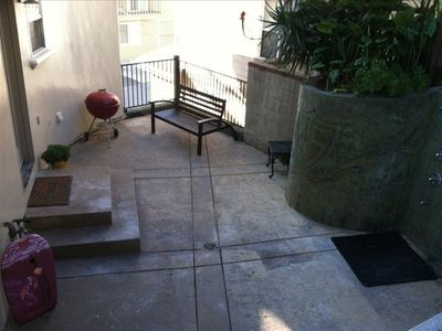Backyard patio w/ grill, bench, and shower. Backyard changing area not in pic
