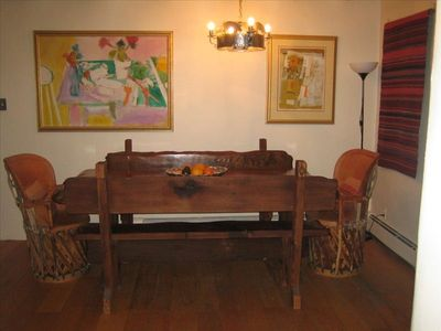 Hand-carved dining table seats 8 easily. Fixtures by award-winning local artist.