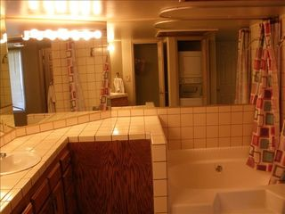 St. George condo photo - Bathroom with shower tub and washer dryer in the c